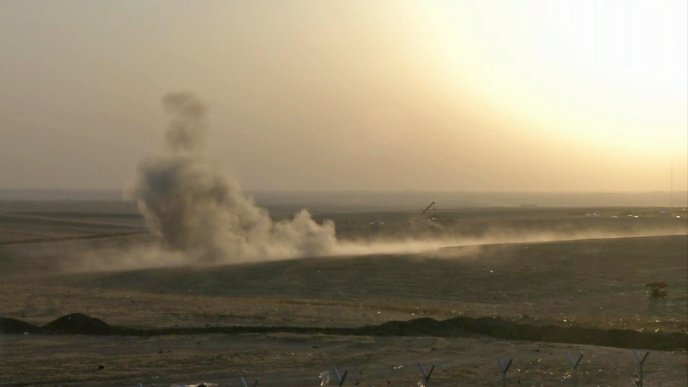 This image made from AP video shows smoke rising from airstrikes targeting Islamic State militants near the Khazer checkpoint outside of the city of Irbil in northern Iraq, Friday, Aug. 8, 2014. (AP Photo via AP video)