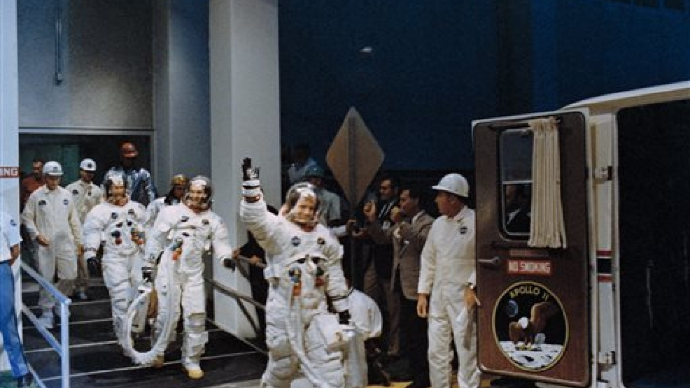 In this July 16, 1969 file photo, Neil Armstrong, waving in front, heads for the van that will take the Apollo 11 crew to the rocket for launch to the moon at Kennedy Space Center in Merritt Island, Fla. NASA renamed the historic building at Florida's Kennedy Space Center on Monday, July 21, 2014, in honor of Armstrong, the first man to step foot on the moon 45 years ago. (AP Photo/NASA, File)
