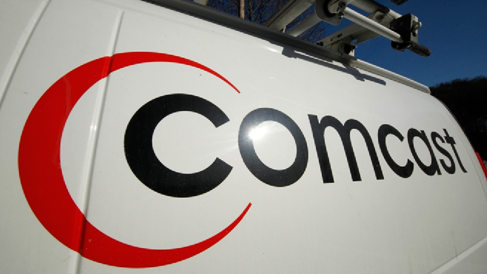 This Feb. 11, 2011 file photo shows the Comcast logo on one of the company's vehicles, in Pittsburgh. (AP Photo/Gene J. Puskar, File)