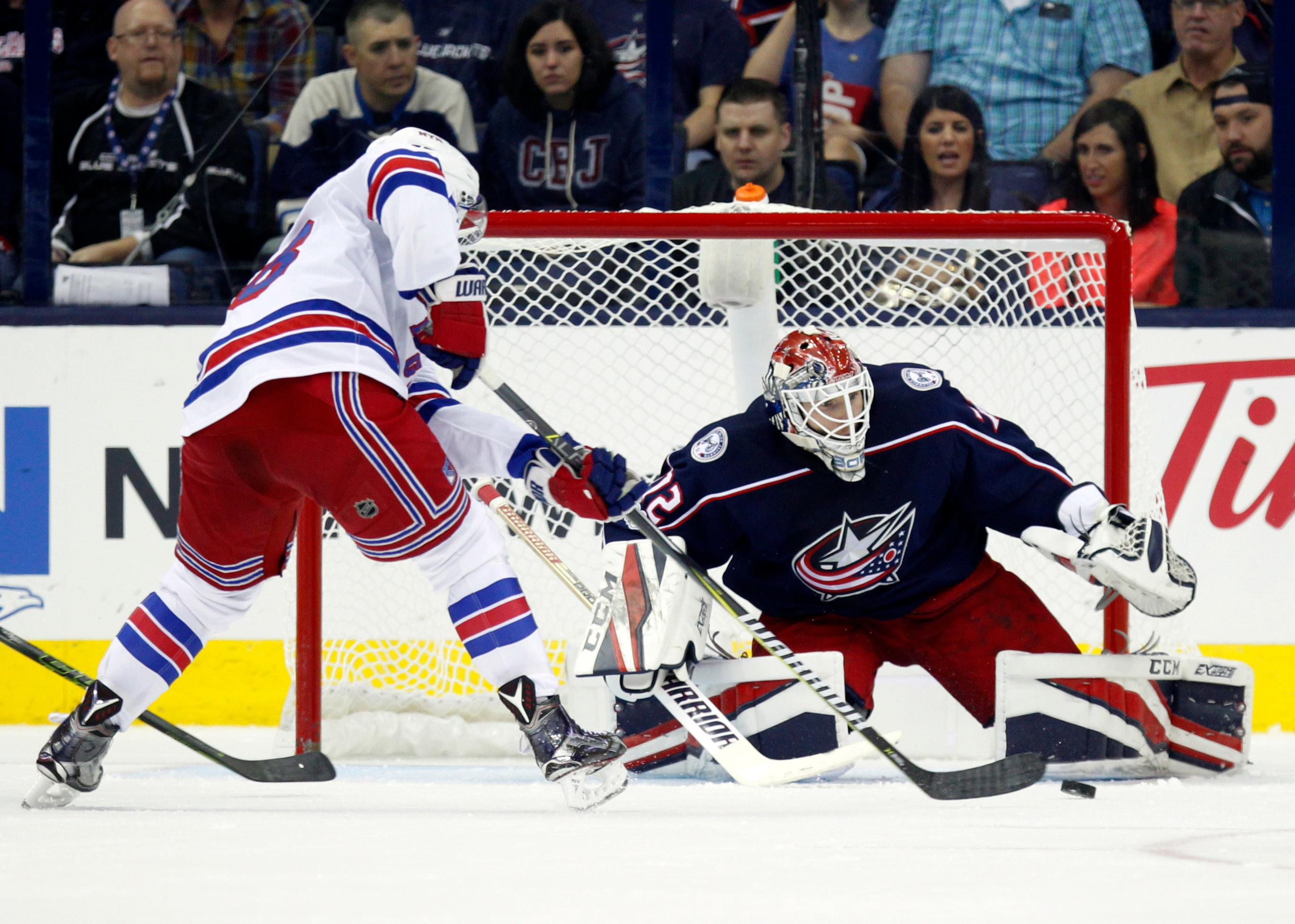 Columbus Blue Jackets goalie Sergei Bobrovsky, right, of Russia, stops a shot by New York Rangers forward Jimmy Vesey during the second period of an NHL hockey game in Columbus, Ohio, Friday, Oct. 13, 2017. (AP Photo/Paul Vernon)
