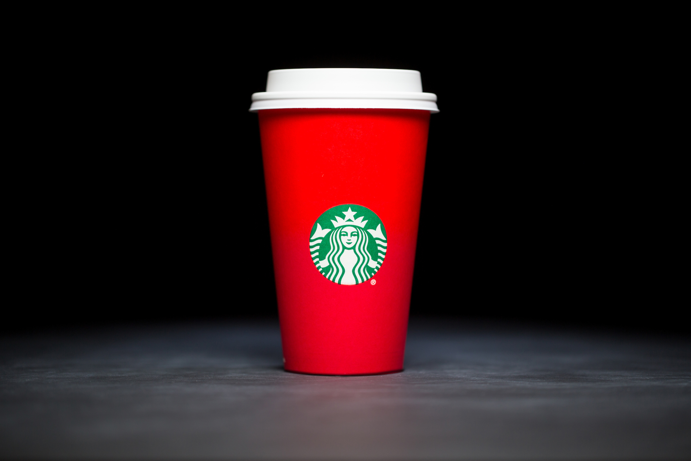 2015: For 20 years, Starbucks have released a range of holiday cup designs, most of them based around their world famous red cup. It's not easy to find the very first Starbucks holiday cups, which made their debut in stores in 1997. Few were saved, and electronic design files were lost in an earthquake in 2001. Even an Internet search is unyielding, with the cups having made their arrival long before the first selfie. But, we have them here! Click on for a photos of all 20 holidays cup designs. (Image: Joshua Trujillo/Cover Images)