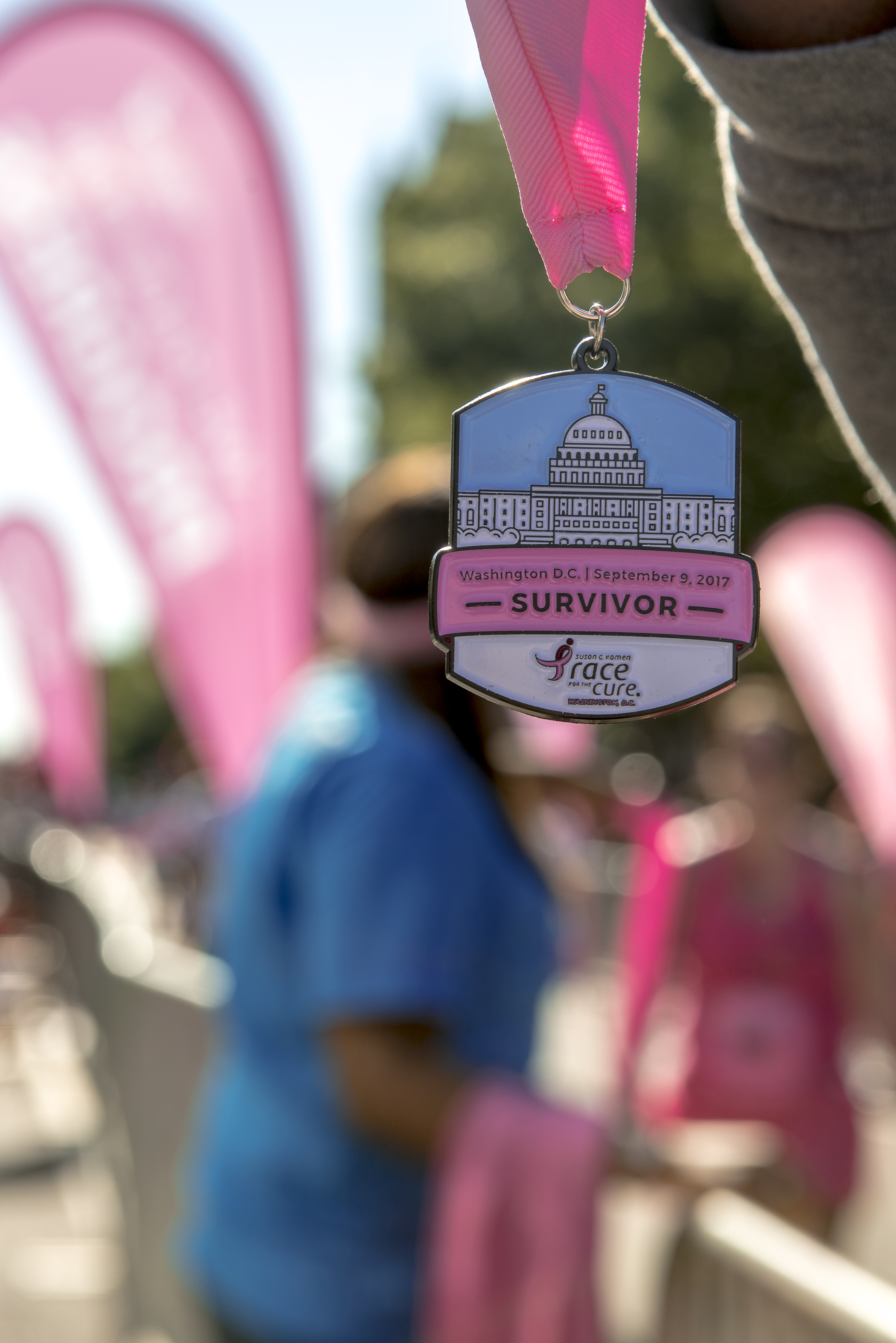 The 28th Annual Komen DC Race for the Cure took place this weekend at Freedom Plaza. The 5k run/walk honors breast cancer survivors, remembers those who succumbed to the battle and helps raise crucial funds for research aimed at finding a cure. Thousands ran, walked or jogged down Pennsylvania Ave. to show their support. (Image: Franz Mahr/ DC Refined)