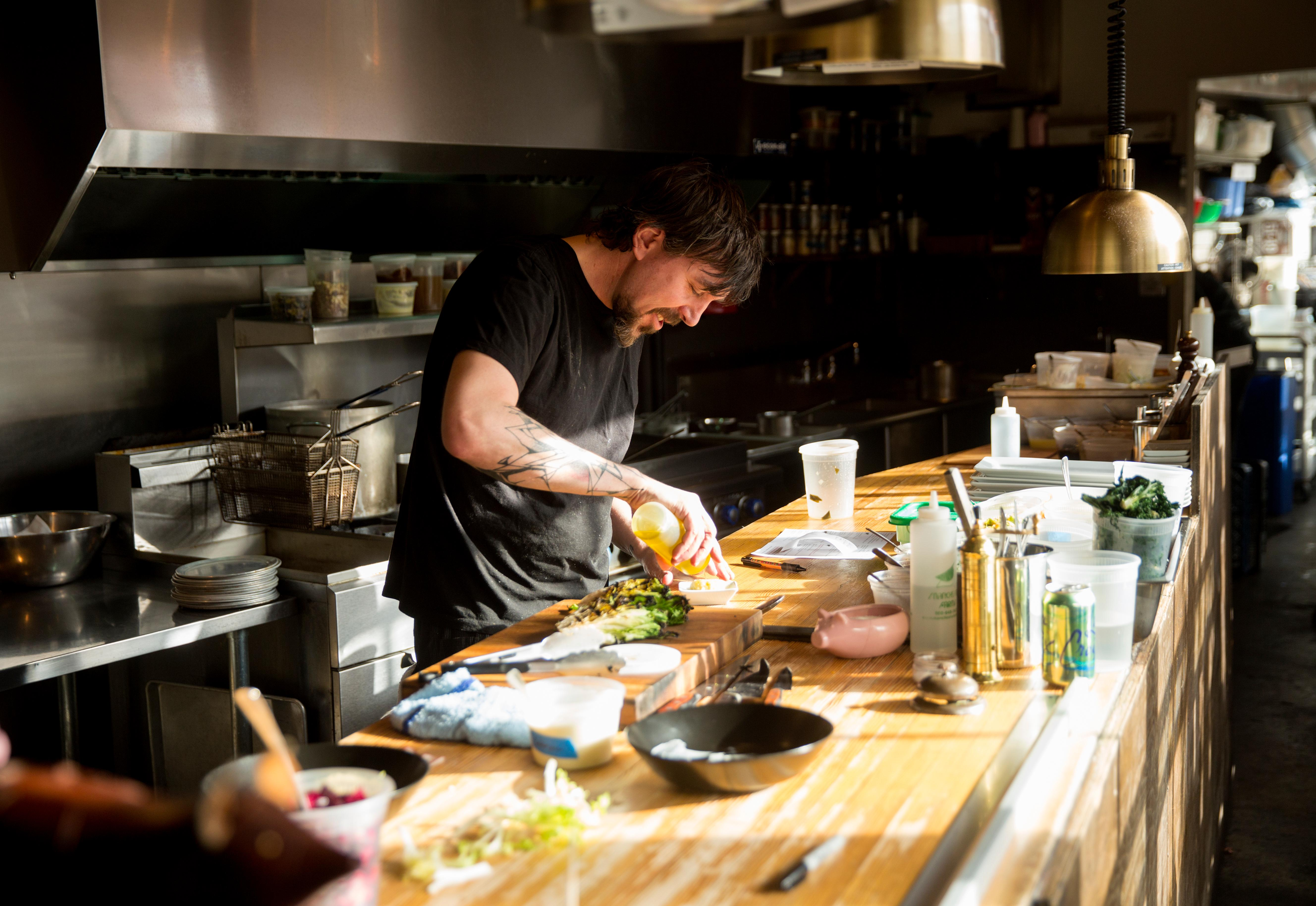 Owner and chef Derek Ronspies at his restaurant, Le Petit Cochon. (Sy Bean / Seattle Refined)