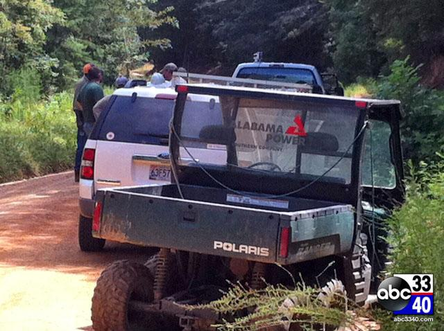 Authorities on the scene of a helicopter crash in Tuscaloosa County that killed two people, Tuesday, August 19, 2014.