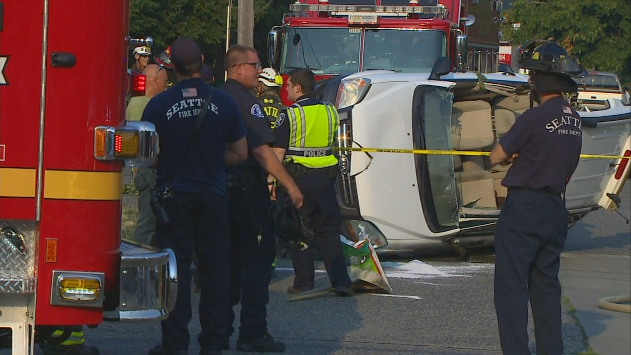 A 38-year-old woman had to be rescued after she was trapped when her SUV landed on it's side following a crash in Seattle's Ravenna neighborhood Wednesday night. (Photo: KOMO News)
