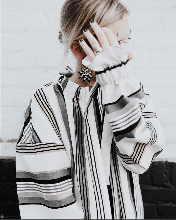 IMAGE: IG user @megbiram / POST: Stripes & stress. 7 ways I deal with stress and a new dress on MB today. How do you deal with stress & anxiety? Share your tips below.