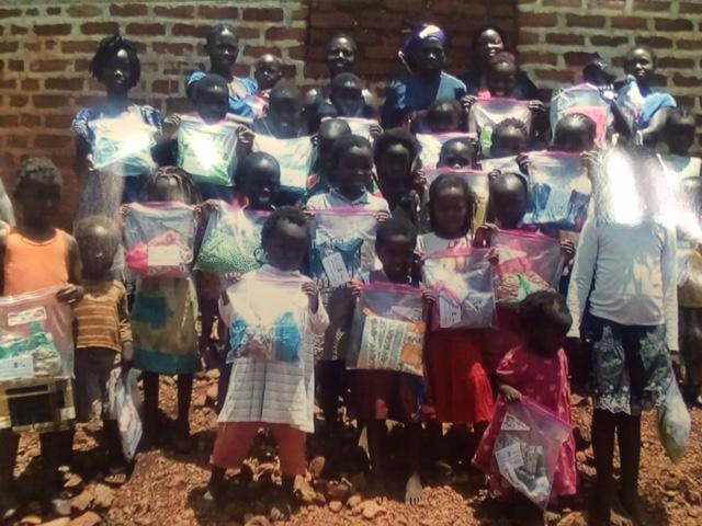 Children who have gotten Suzie's clothes with the non-profit organization, Sewing For Souls. (Image: WTVC)