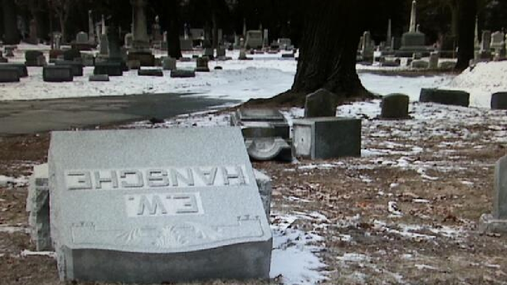 Twenty-four gravestones at Mound Cemetery in Racine were discovered damaged and pushed off their bases Monday.