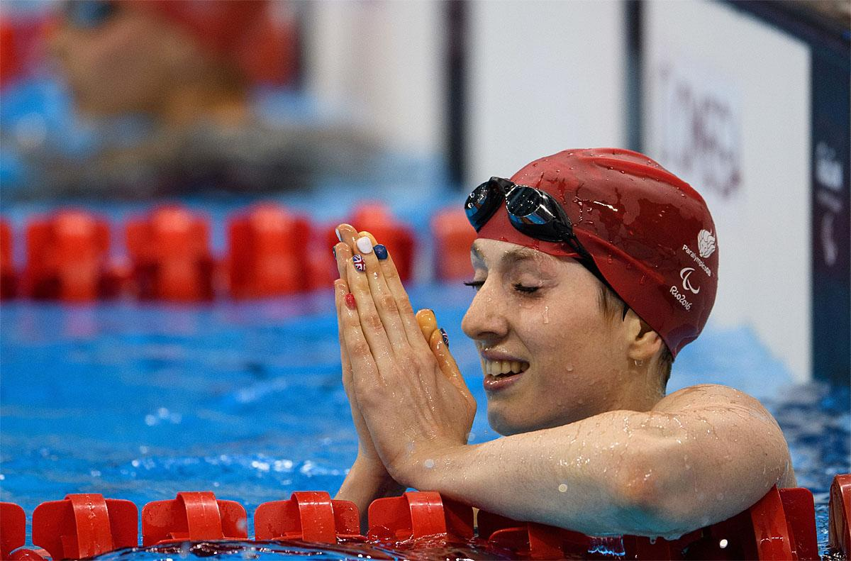 In this photo provided by the IOC, Britain's Bethany Firth celebrates after winning the gold medal and breaking the world record in the women's 100-meter backstroke - S14 swimming final of the Paralympic Games in Rio de Janeiro, Brazil, Thursday, Sept. 8, 2016. (Bob Martin/OIS, IOC via AP)