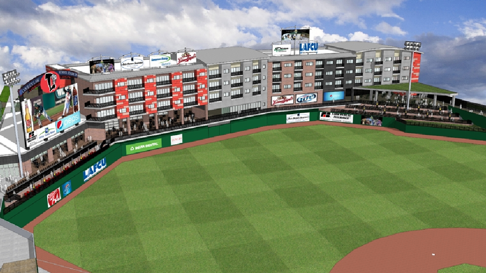 This rendering released by the Lansing Lugnuts shows proposed apartments beyond the outfield of Cooley law School Stadium in Lansing, Mich.