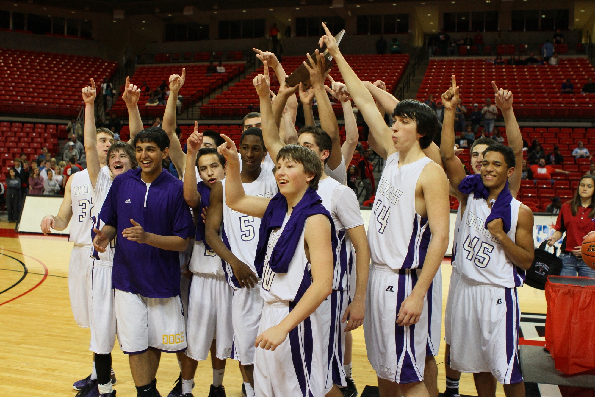 Wylie players celebrated after defeating Wichita Falls Hirschi 57-55 in the regional finals to advance to the state tournament in Austin.The No. 5-ranked Bulldogs (34-4) are scheduled to play No. 2-ranked Dallas Madison (30-4) at 1:30 p.m. Thursday in the semifinals of the Class 3A Final Four.Photo by Tim Nelson/WylieSports.com