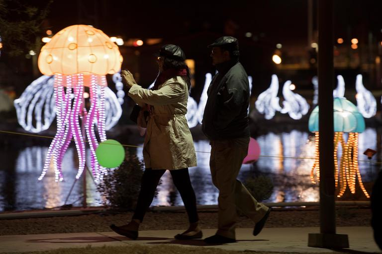 A woman takes video as she walks along a path on the opening night of the China Lights lantern festival Friday, January 19, 2018, at Craig Ranch Regional Park in North Las Vegas. The festival, which features nearly 50 silk and LED light displays comprised of over 1000 elements, runs through February 25th. CREDIT: Sam Morris/Las Vegas News Bureau