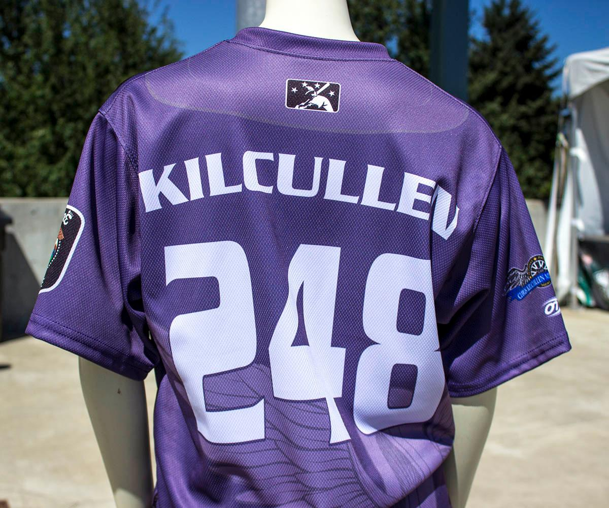 Five years after Officer Chris Kilcullen died on duty, Danny Cowley designed this police officer-inspired jersey in his honor. The Eugene Emeralds will hold a Throwback Thursday and Teacher Appreciation Night August 18. Teachers can get free box seats. (Photo by Amanda Butt)