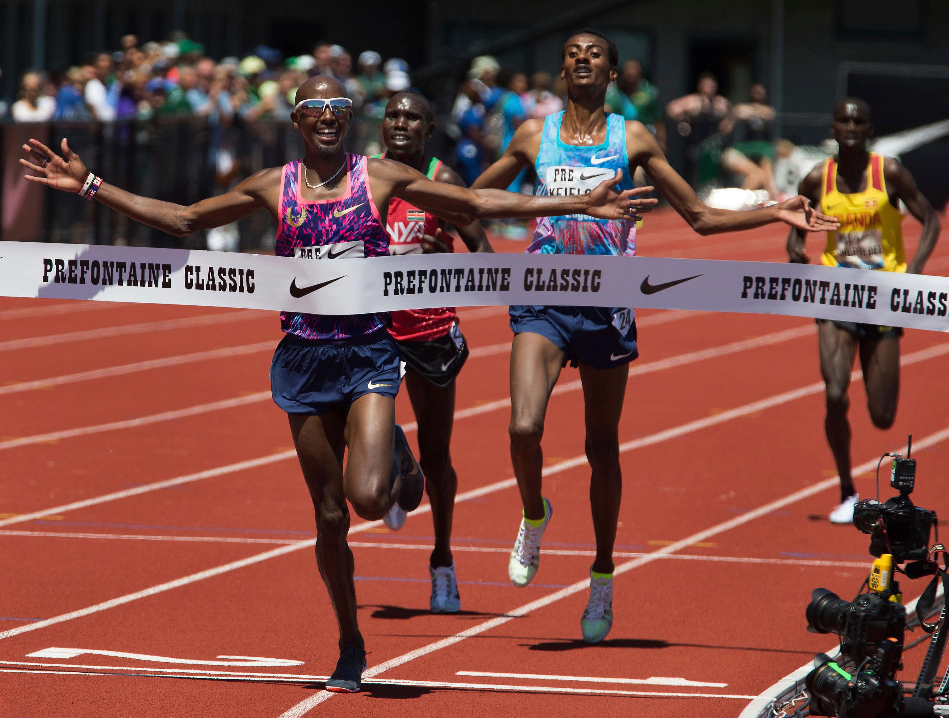 Mo Farah celebrates as he reaches to the finish line in the men's 5,000 meters in his last race in the U.S. at the IAAF Diamond League Prefontaine Classic at Hayward Field in Eugene, Ore., Saturday, May 27, 2017. (Brian Davies/The Register-Guard via AP)