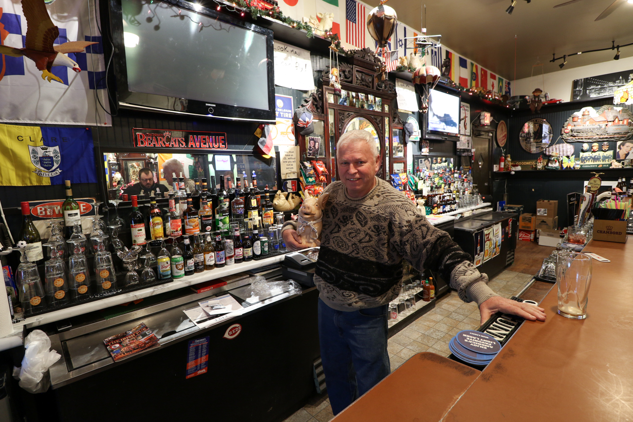 "Owner John Cody poses behind the bar of his ""toy,"" the Flying Pig Irish Pub / Image: Ronny Salerno // Published: 2.4.19"