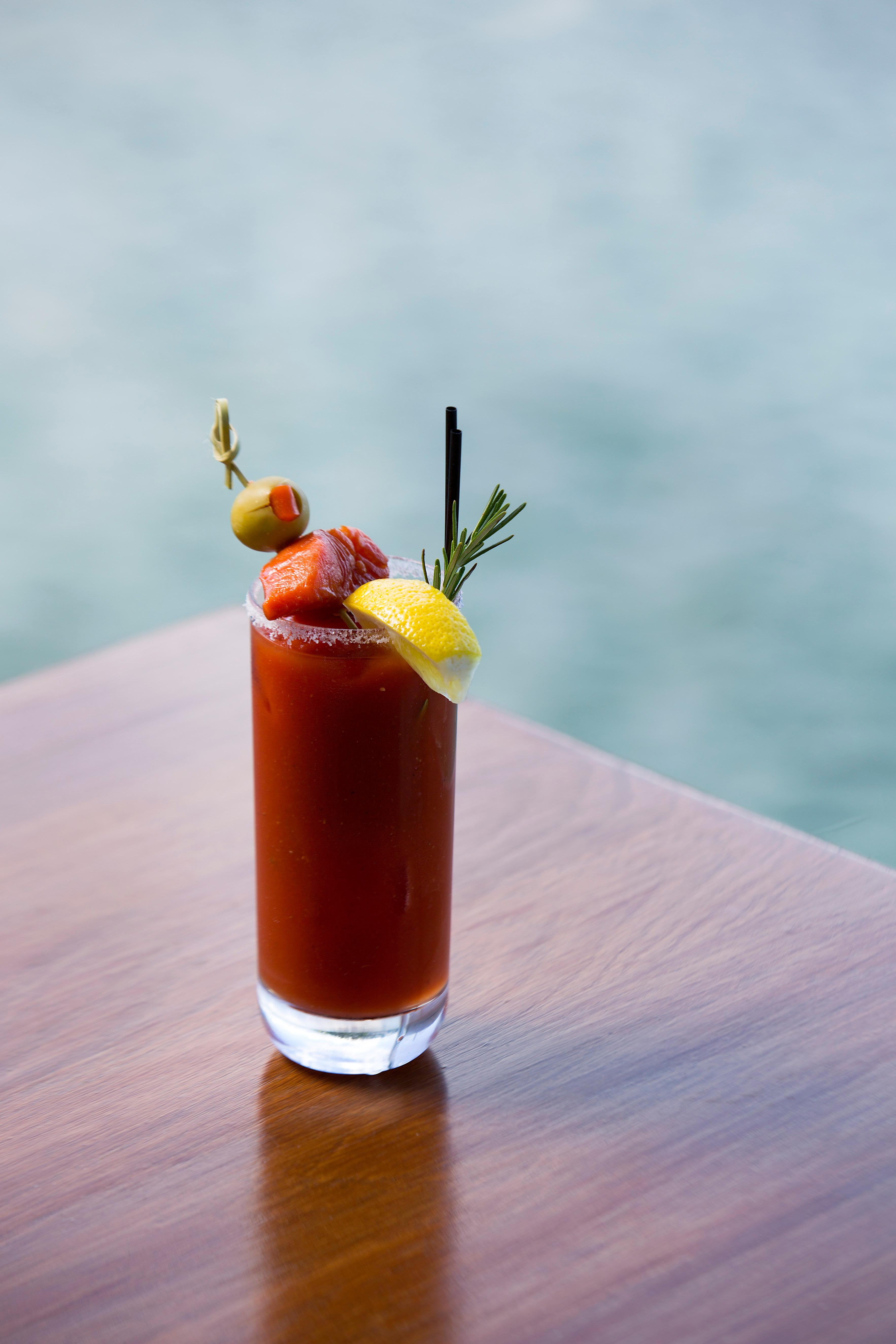 Ray's Bloody Mary, consisting of house infused with garlic vodka with classic Dimitri's bloody mix, spicy salt rim, and in-house smoked salmon. (Sy Bean / Seattle Refined)