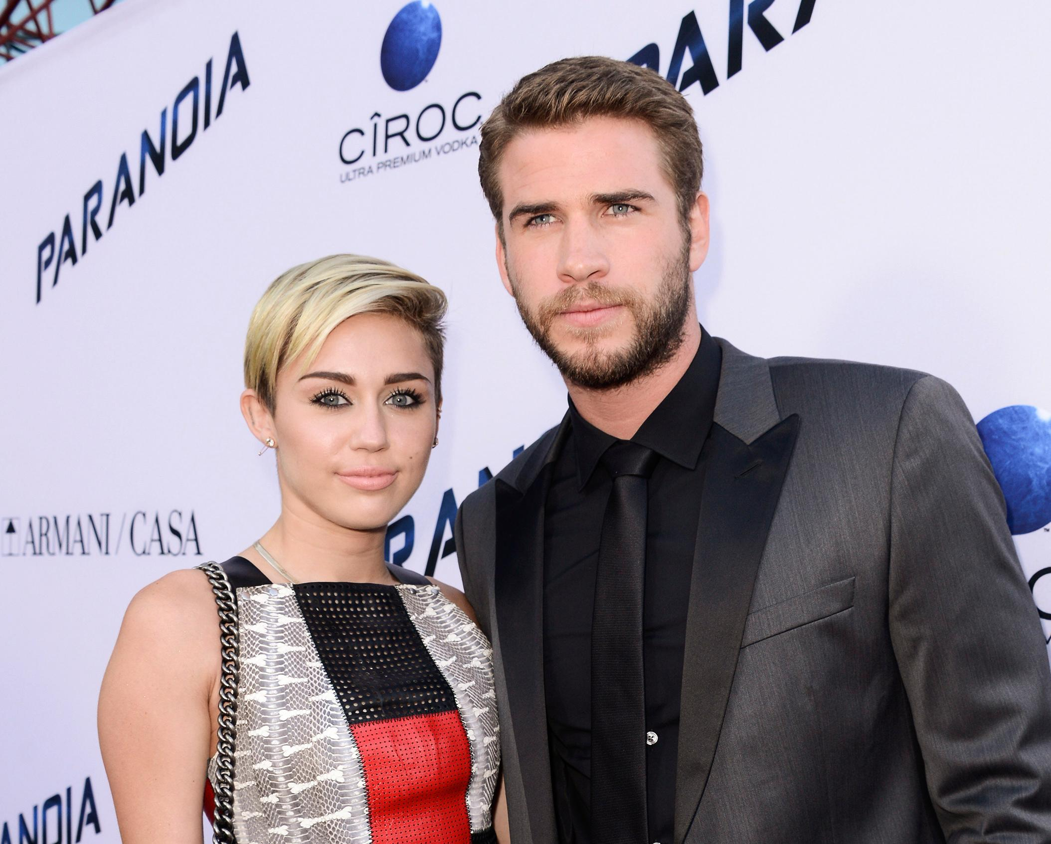 "FILE - In this Aug. 8, 2013, file photo, actor Liam Hemsworth and singer and actress Miley Cyrus arrive on the red carpet at the US premiere of the feature film ""Paranoia"" at the DGA Theatre in Los Angeles. (Photo by Dan Steinberg/Invision/AP, File)"