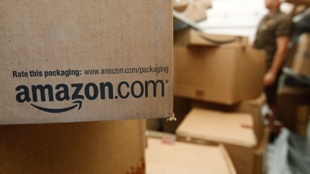 FILE - In this Oct. 18, 2010 file photo, an Amazon.com package awaits delivery from UPS in Palo Alto, Calif. (AP Photo/Paul Sakuma, File)
