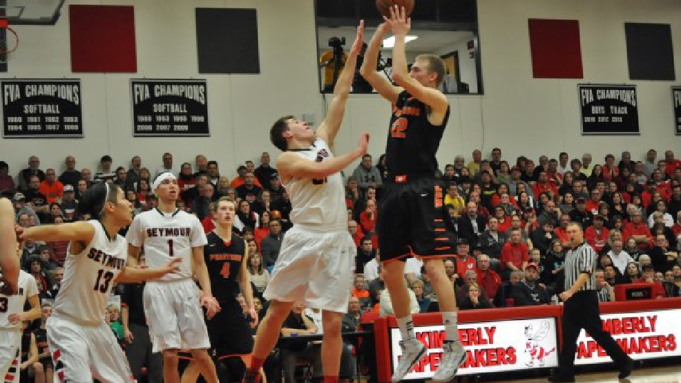 West De Pere's Chandler Diekvoss shoots over Seymour's Brayden Wilinksi during their game Thursday. (Doug Ritchay/WLUK-TV)