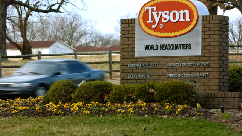 FILE - In this Jan. 29, 2006, file photo, a car passes in front of a Tyson Foods Inc., sign at Tyson headquarters in Springdale, Ark. (AP Photo/April L. Brown, File)