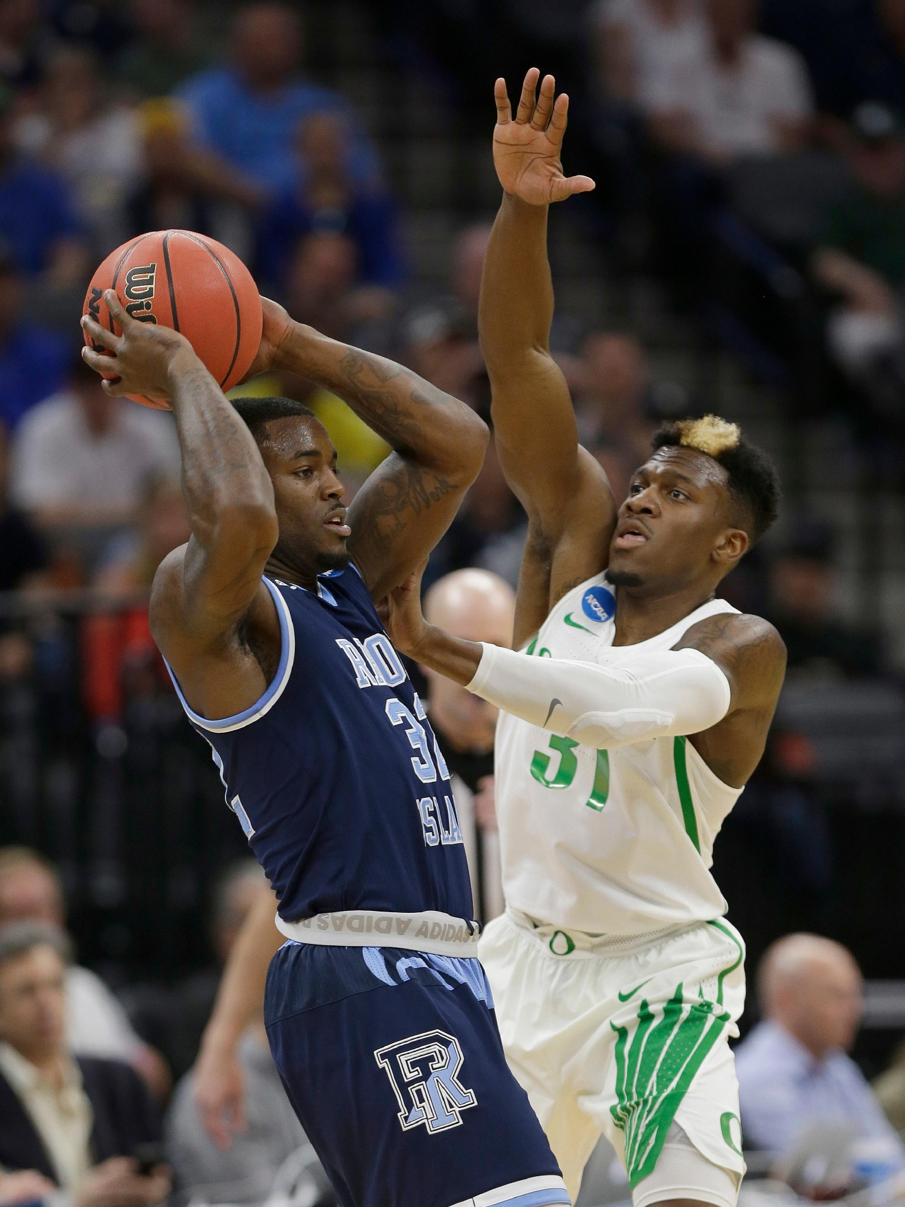 Rhode Island guard Jared Terrell, left, looks to pass against Oregon guard Dylan Ennis during the first half of a second-round game of the NCAA men's college basketball tournament in Sacramento, Calif., Sunday, March 19, 2017. (AP Photo/Rich Pedroncelli)