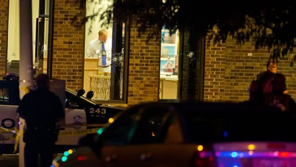 "In this Tuesday, Aug. 26, 2014 photo, Omaha police are on the scene of an officer-involved shooting in Omaha. A suspect was shot dead and a crewman with the ""Cops"" television show was wounded. (AP Photo/THe Omaha World-Herald, Chris Machian)"