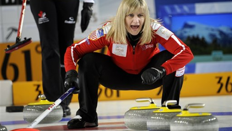U.S.'s skip Erika Brown shouts during a bronze medal game against Canada at the World Women's Curling Championship in Riga, Latvia, Sunday, March 24, 2013.  (AP Photo/Roman Koksarov)