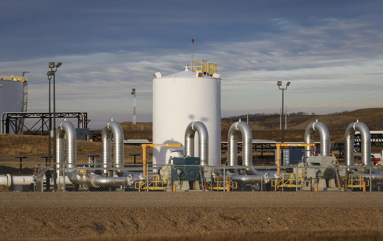 FILE - In this Nov. 6, 2015 file photo, TransCanada's Keystone pipeline facilities are seen in Hardisty, Alberta. (Jeff McIntosh/The Canadian Press via AP, File)<p></p>