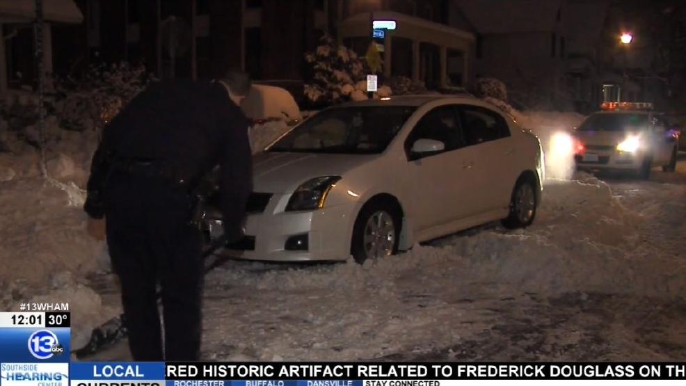 Cop shovels woman out.JPG