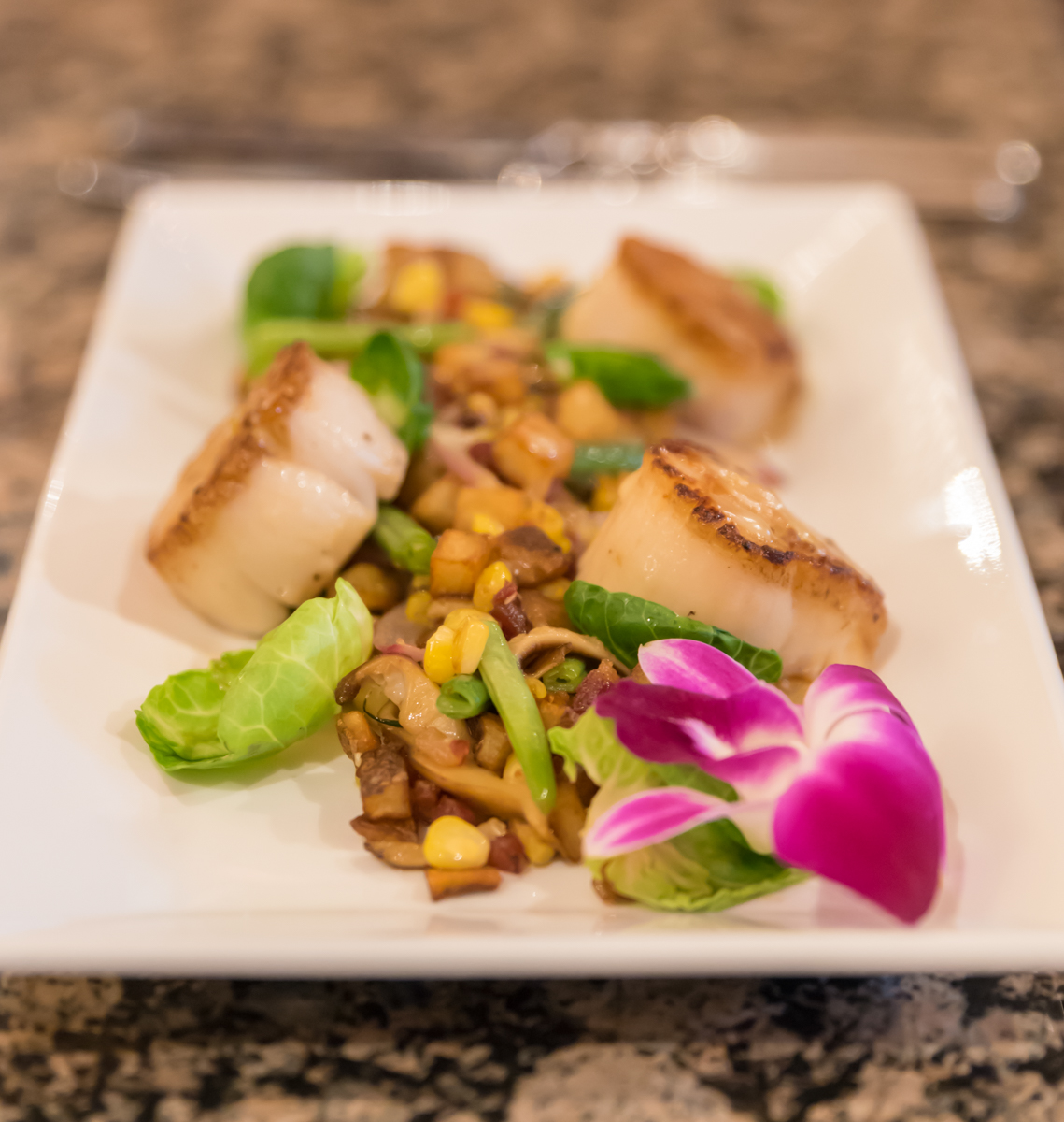 Scallops and Hash: caramelized scallops over potato hash with diced red onion, shiitake mushrooms, roasted corn, candied pancetta, haricot verts, and citrus vinaigrette / Image: Sherry Lachelle Photography // Published: 3.21.18