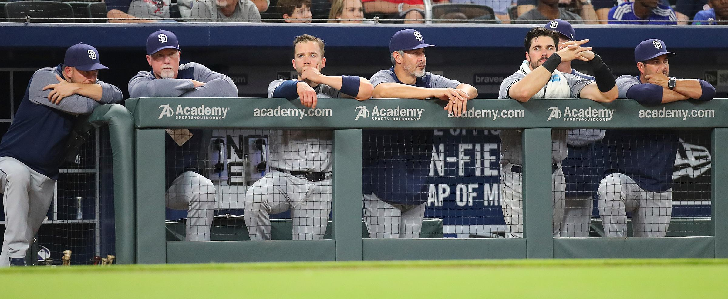 The San Diego Padres players watch their game against the San Diego Padres from the bench during a baseball game in Atlanta on Monday, April 17, 2017. Atlanta won, 5-4. (Curtis Compton/Atlanta Journal-Constitution via AP)