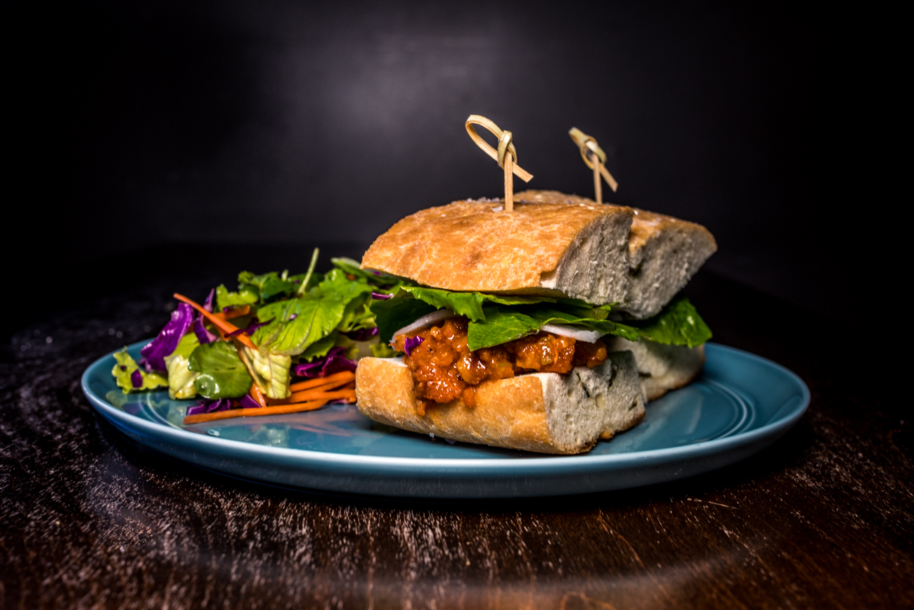 Spicy Korean Pork Belly Sandwich: gochujang-marinated pork belly, pickled daikon, and lettuce served on Pang bread / Image: Catherine Viox{ }// Published: 1.8.20