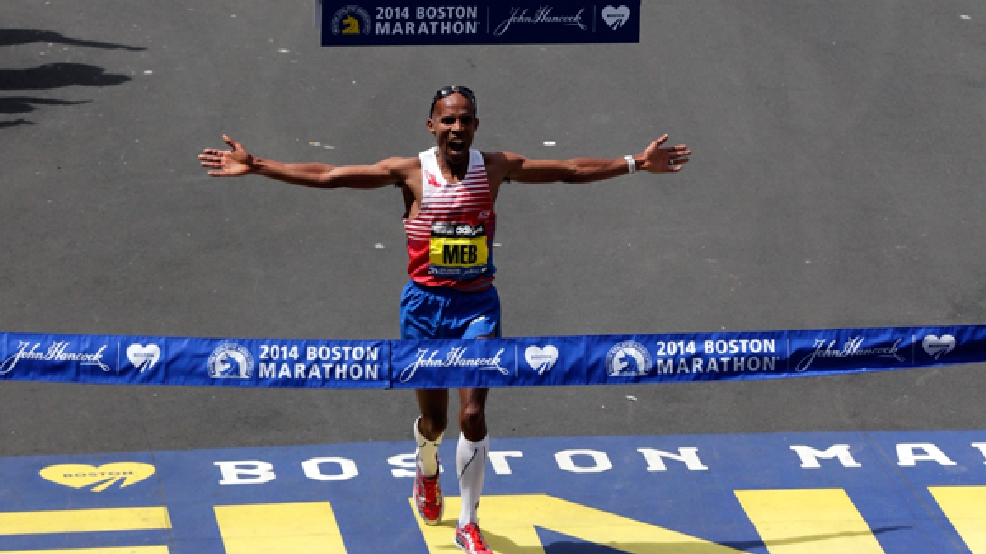 Meb Keflezighi, of San Diego, Calif., celebrates as he crosses the finish line to win the 118th Boston Marathon, Monday, April 21, 2014, in Boston. (AP Photo/Charles Krupa)