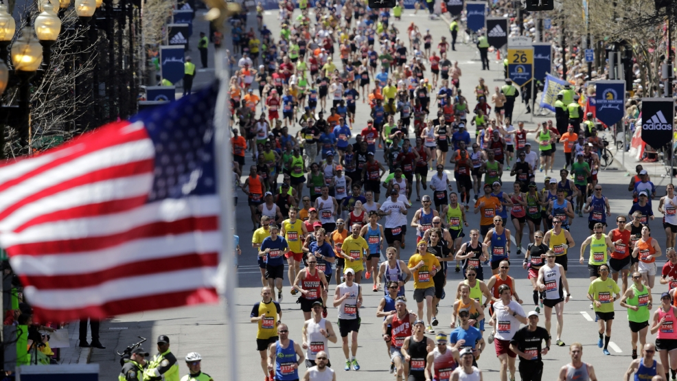 Runners head to the finish line in the 118th Boston Marathon, Monday, April 21, 2014, in Boston. (AP Photo/Charles Krupa)