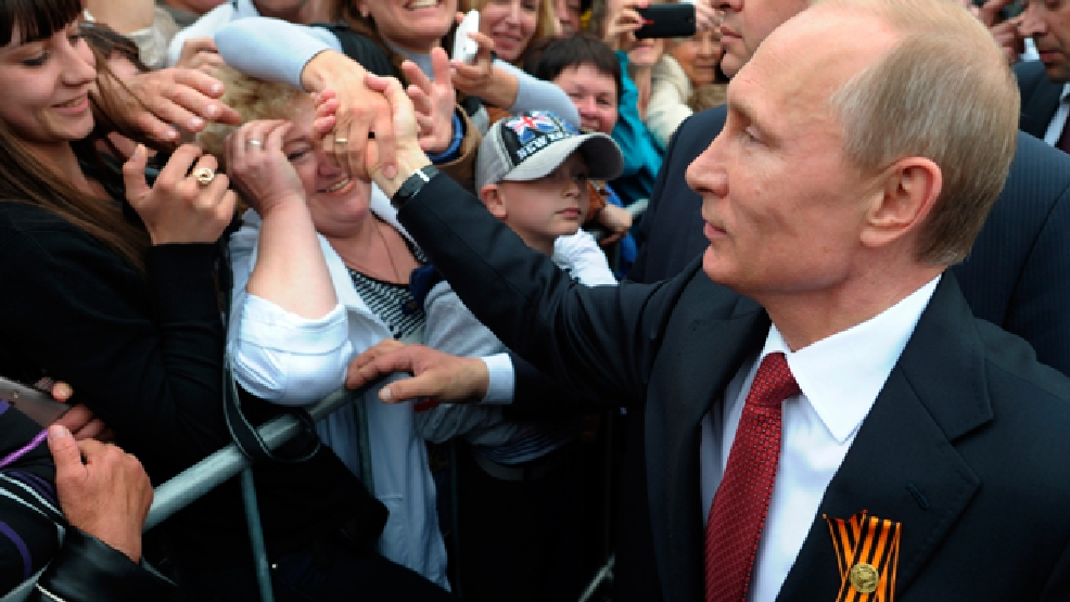 Russian President Vladimir Putin, center, is greeted by people in Sevastopol where he attends celebrations marking the Victory Day, Crimea, Friday, May 9, 2014. (AP Photo/RIA-Novosti, Alexei Druzhinin, Presidential Press Service)