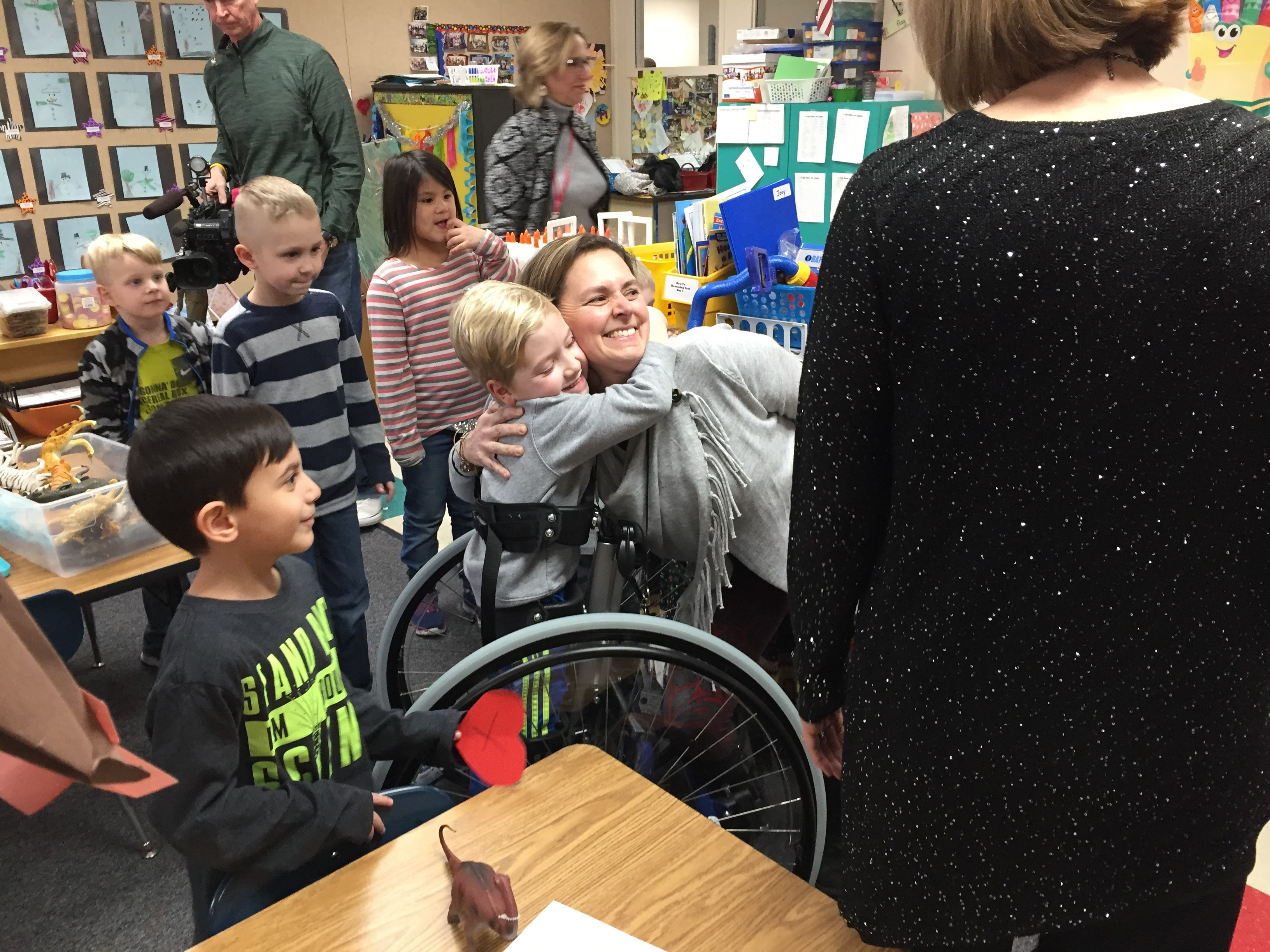Kindergarten teacher April Moran receives a hug from a student after being announced as a Golden Apple Award recipient Feb. 7, 2018, at the Cormier Early Learning Center in Ashwaubenon. (WLUK/Donna Fischer)