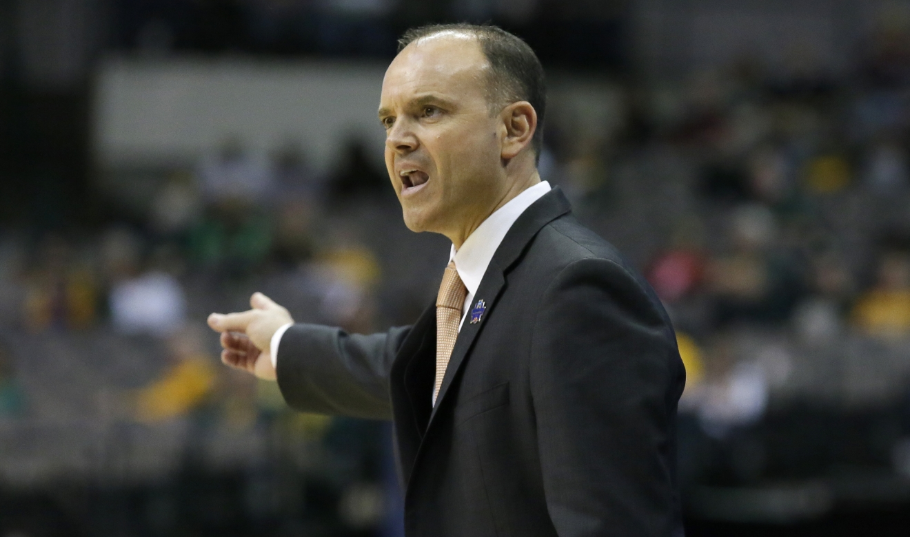 Oregon state head coach scott rueck gives directions during the first