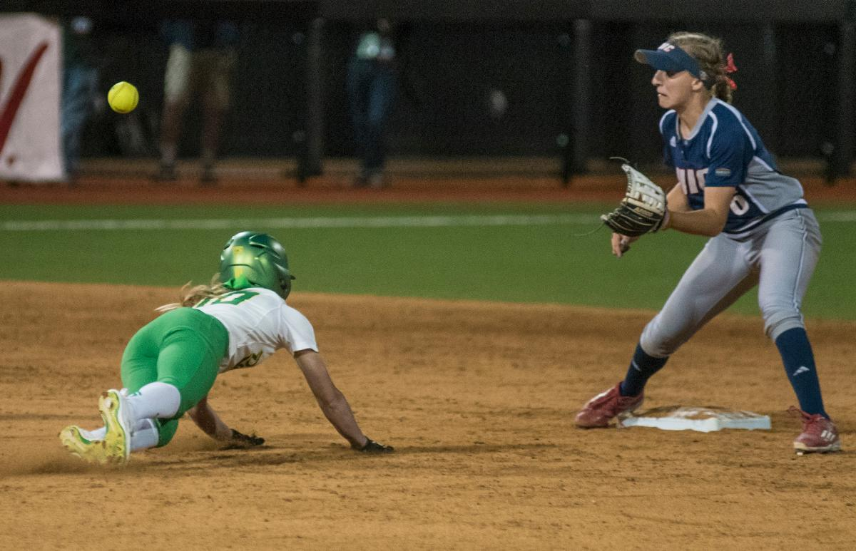 Oregon Ducks Alexis Mack (#10) attempts to steal second base as Chicago Flames Kayla Wedl (#6) reaches for the ball. The No. 3 Oregon Ducks defeated the University of Illinois Chicago Flames 13-0 with the run-rule on Saturday night at Jane Sanders Stadium. The Ducks scored in every inning and then scored nine runs at the bottom of the fourth. The Oregon Ducks are now 22-0 in NCAA regional games. The Oregon Ducks play Wisconsin next on Saturday, May 20 at 2pm at Jane Sanders Stadium. Photo by Cheyenne Thorpe, Oregon News Lab