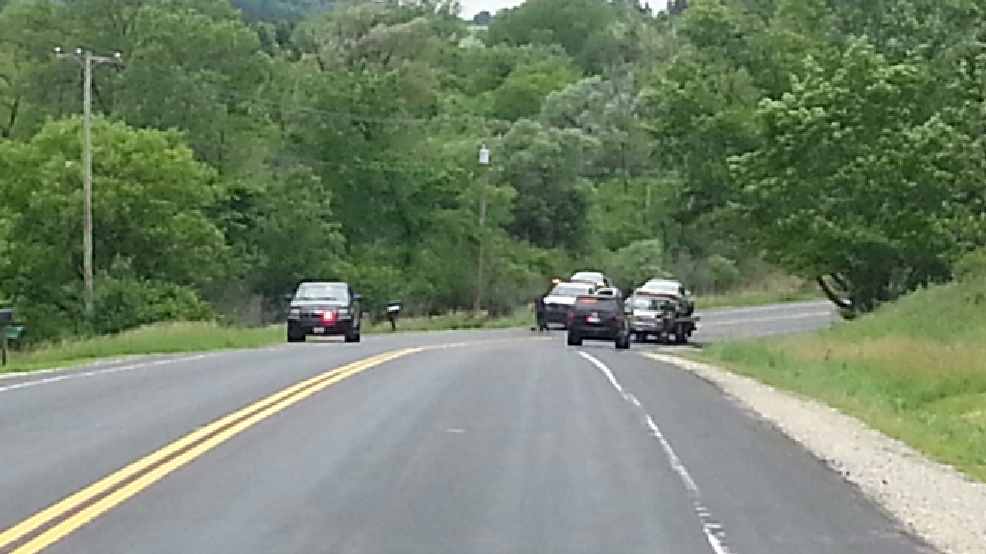 Authorities investigate a fatal crash involving a sheriff's squad car, June 18, 2014, in Kewaskum. (WITI-TV)