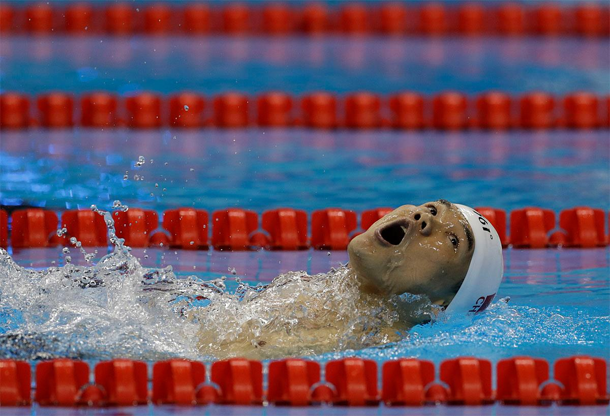 Zheng Tao of China competes in the men's 100-meter backstroke S6 swimming event at the Paralympic Games in Rio de Janeiro, Brazil, Thursday, Sept. 8, 2016. (AP Photo/Leo Correa)