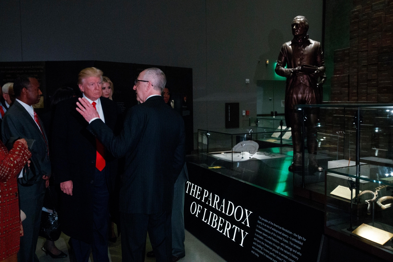 Secretary of the Smithsonian David Skorton talks with President Donald Trump as he tours the National Museum of African American History and Culture, Tuesday, Feb. 21, 2017, in Washington. (AP Photo/Evan Vucci)