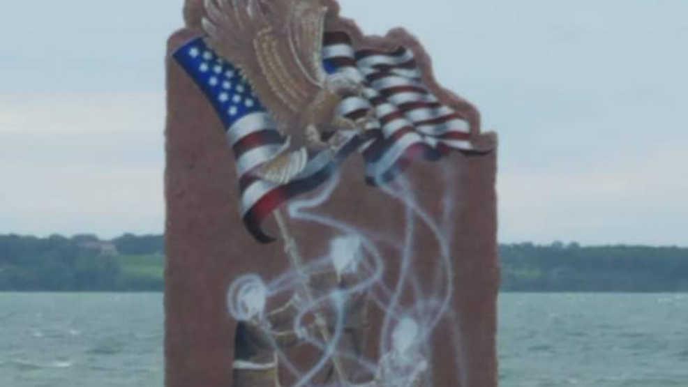 Woman arrested in 9/11 memorial vandalism case in Geneva