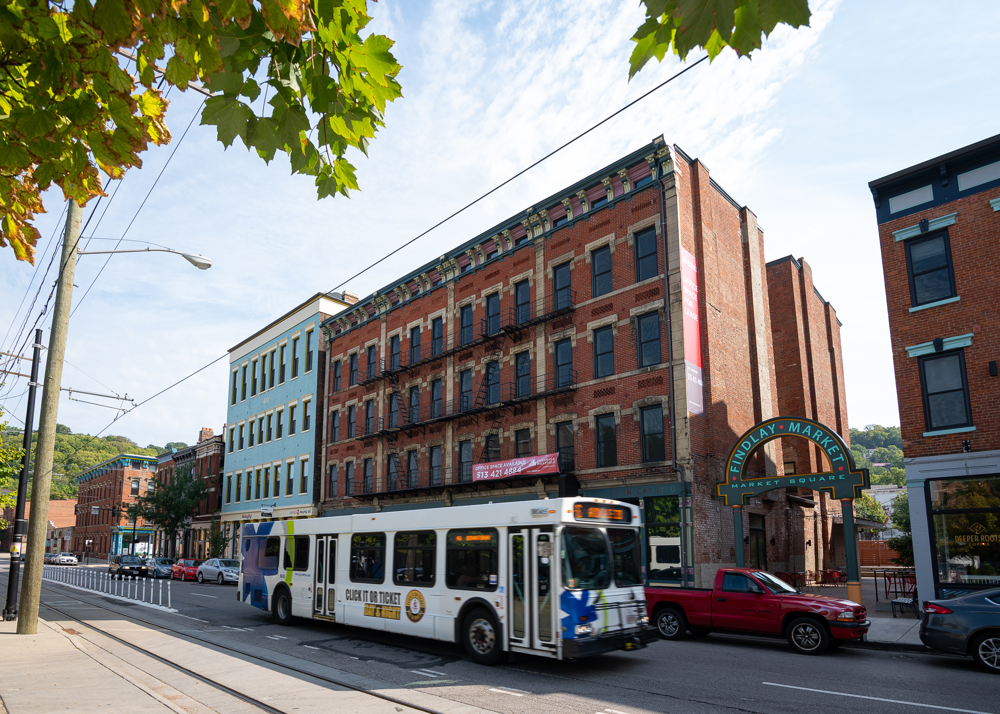 The office building is across the street from Findlay Market on Race Street. A streetcar stop, coffee shop, and other helpful amenities make the spot attractive to Ovare's employees. / Image: Phil Armstrong, Cincinnati Refined // Published: 9.5.19