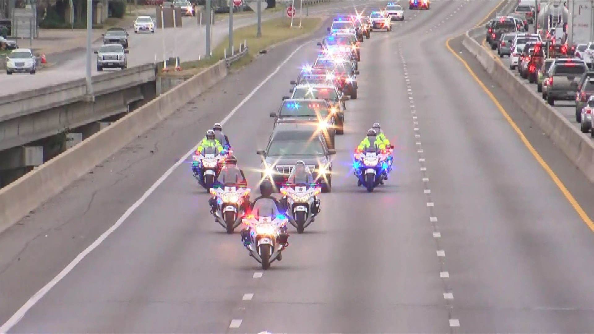 The body of Officer Ken Copeland was escorted from Austin to a funeral home in San Marcos on Tuesday afternoon. (Photo: CBS Austin)