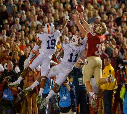 Auburn's Ryan White (19) and Chris Davis (11) break up a pass intended for Florida State's Nick O'Leary (35) during the first half of the NCAA BCS National Championship college football game Monday, Jan. 6, 2014, in Pasadena, Calif.