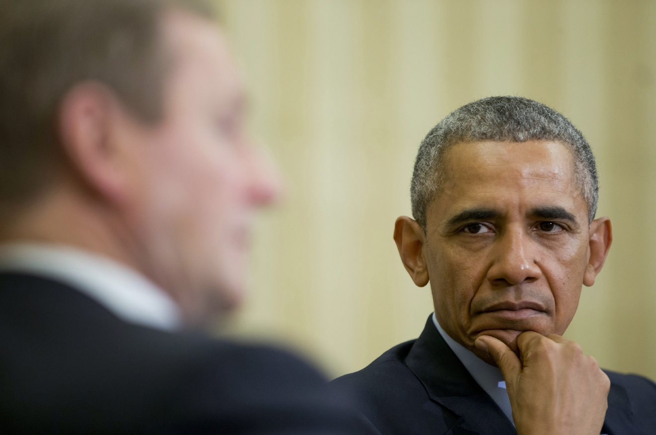 President Barack Obama, right, listens to  Irish Prime Minister Enda Kenny, left, make comments during their meeting in the Oval Office of the White House in Washington, Tuesday, March 15, 2016. (AP Photo/Pablo Martinez Monsivais)
