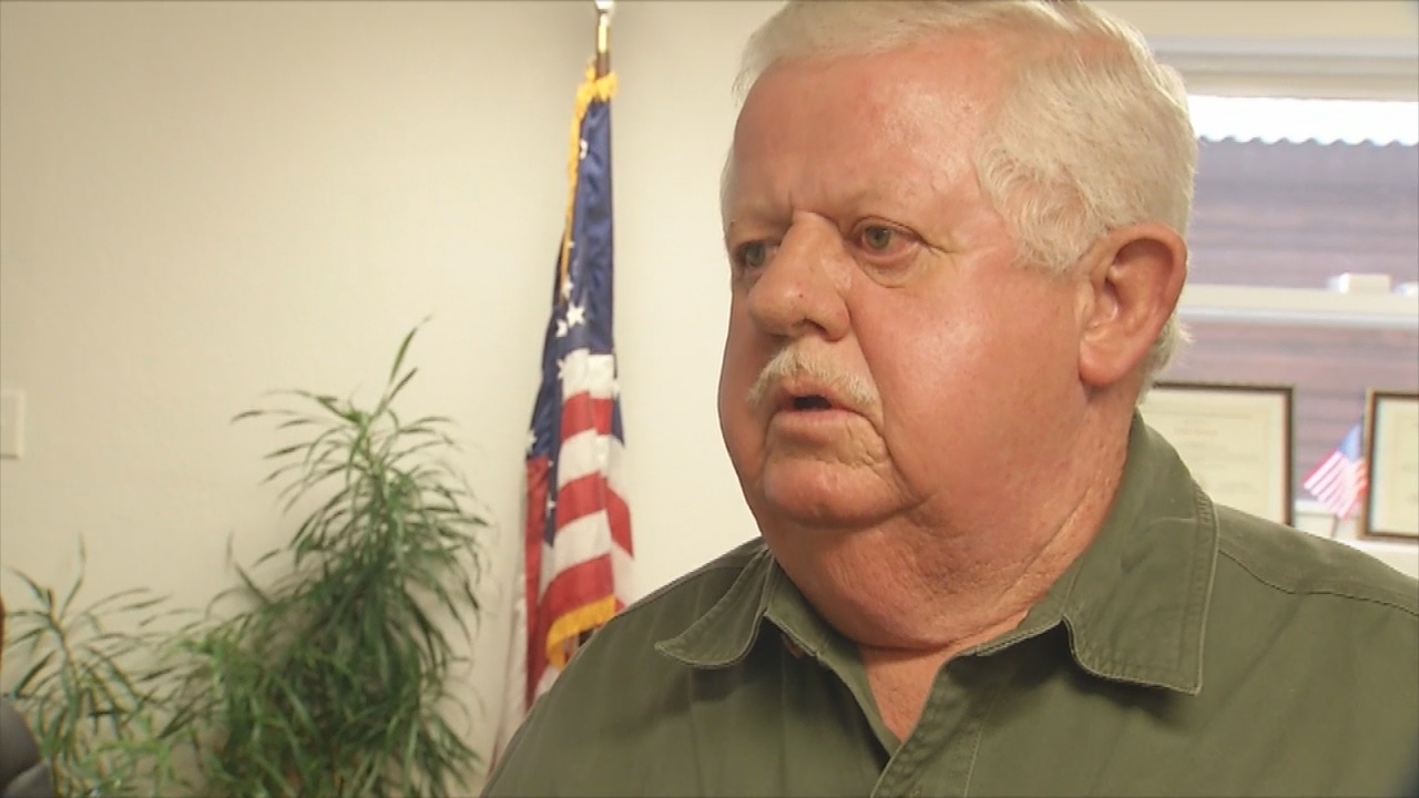 Jerry Lowery, who has accused Swain County Sheriff Curtis Cochran of having been dishonorably discharged from the military, was arrested Monday night after a Swain County Board of Elections meeting about the allegations. (Photo credit: WLOS staff)