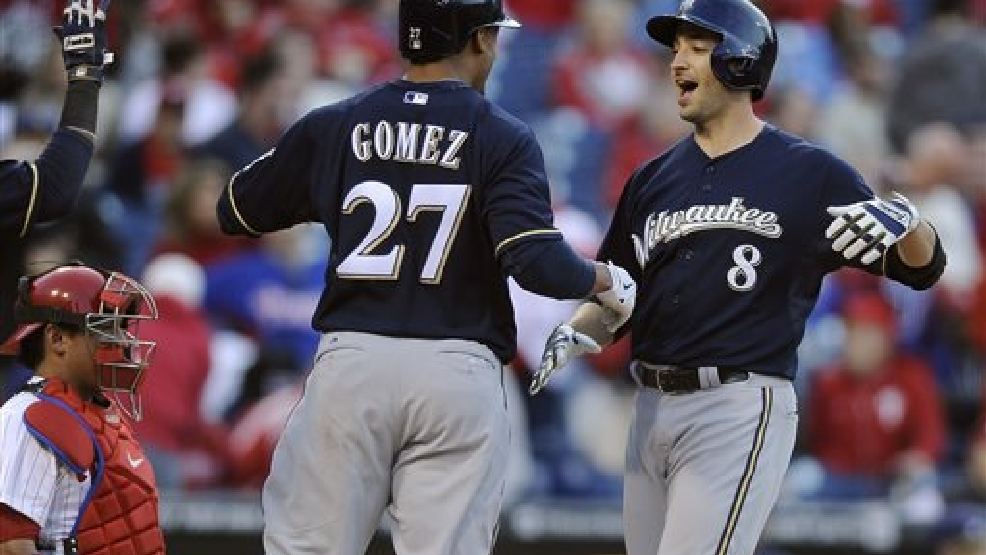 Milwaukee Brewers' Ryan Braun (8) scores on his three-run home run and celebrates with Carlos Gomez in the eighth inning of a baseball game against the Philadelphia Phillies on Tuesday, April 8, 2014, in Philadelphia. The Brewers won 10-4. (AP Photo/Michael Perez)