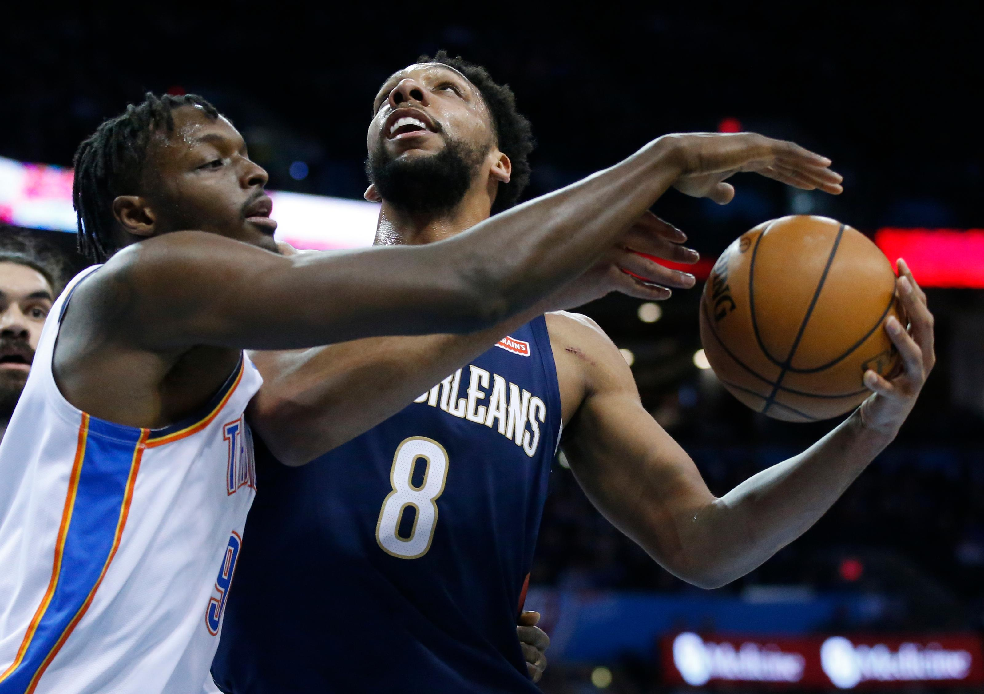 New Orleans Pelicans center Jahlil Okafor (8) is defended by Oklahoma City Thunder forward Jerami Grant (9) during the first half of an NBA basketball game in Oklahoma City, Thursday, Jan. 24, 2019. (AP Photo/Sue Ogrocki)