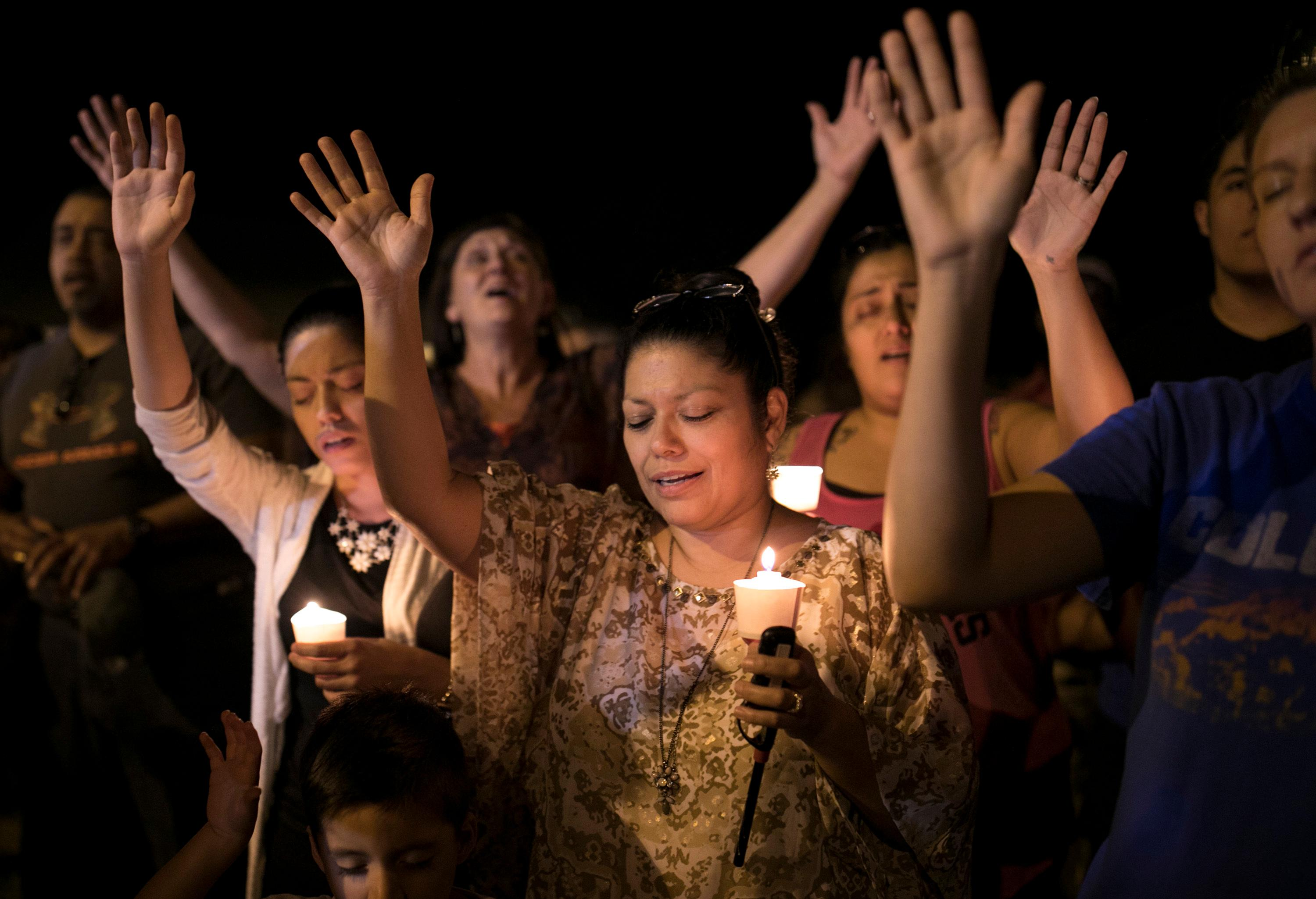 Mourners participate during a candlelight vigil held for the victims of a fatal shooting at the First Baptist Church of Sutherland Springs, Sunday, Nov. 5, 2017, in Sutherland Springs, Texas. (Jay Janner/Austin American-Statesman via AP)